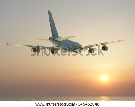 corporate jet airplane flying at sunset - stock photo