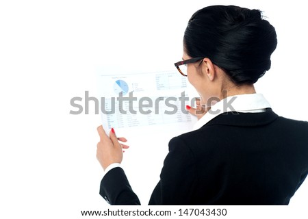Corporate lady cross checking sales report - stock photo