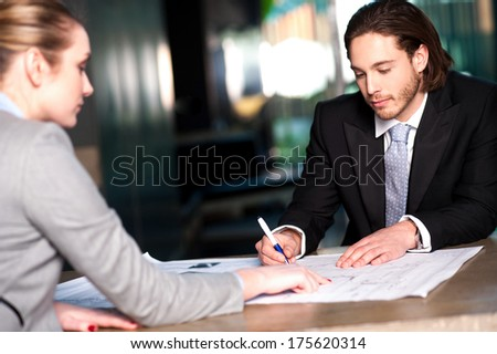 Corporate lady explaining business concepts to her colleague - stock photo