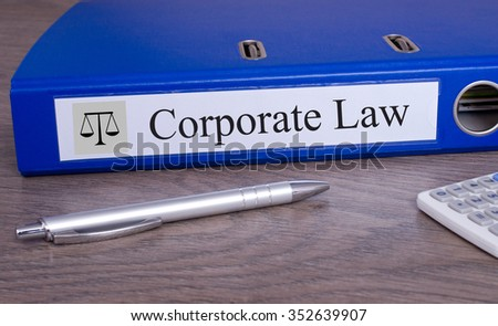 Corporate Law blue binder with pen on desk in the office