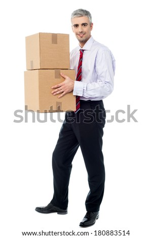 Corporate man with a cardboard box in hand - stock photo
