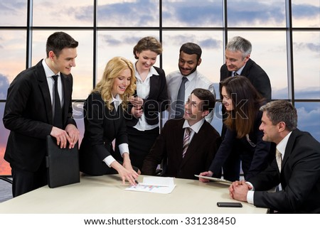 Corporate meeting. Managers of the company to discuss of business project. Businessmen against the evening sky. - stock photo