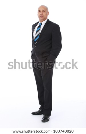 Corporate portrait of a smart intelligent businessman wearing black suit with blue striped tie looking serious and checking the time on his watch
