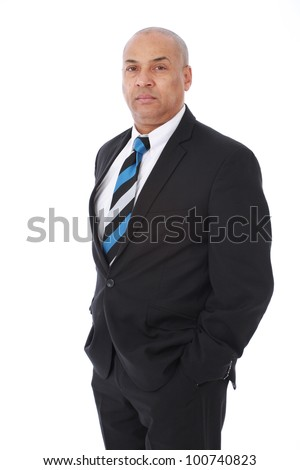 Corporate portrait of a smart intelligent businessman wearing black suit with blue striped tie looking serious