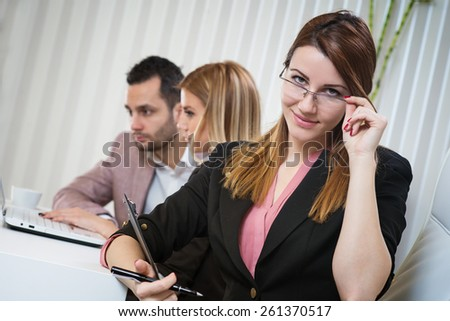 Corporate portrait of beautiful business woman at office.