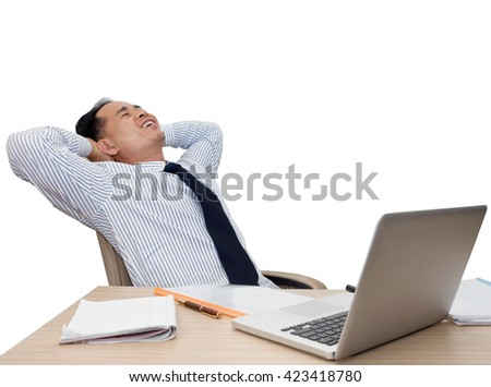 corporate portrait of young asian businessman leaning back on his chair in front of laptop. Relaxed, smiling, happy and satisfied in business. Isolated on white background. Success concept - stock photo