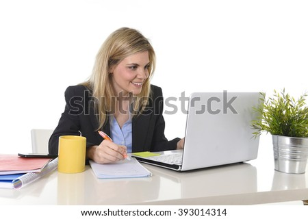corporate portrait young happy Caucasian blond business woman working on laptop computer at modern office desk smiling confident drinking coffee in successful female executive concept