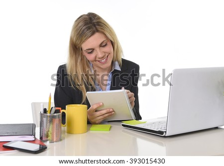 corporate portrait young happy Caucasian blond business woman working using digital tablet pad at office computer desk smiling confident in successful female executive concept