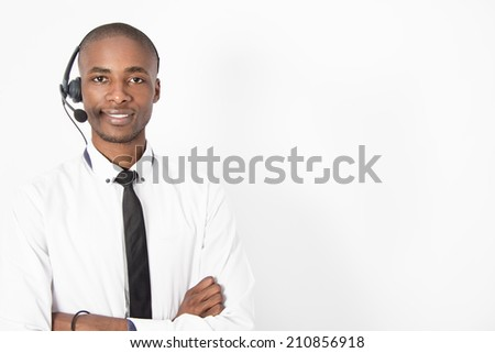 Corporate Professional Call Centre Agent with headphones on his head - stock photo