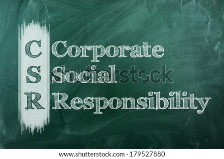 Corporate social responsibility (CSR) concept on green  chalkboard  - stock photo