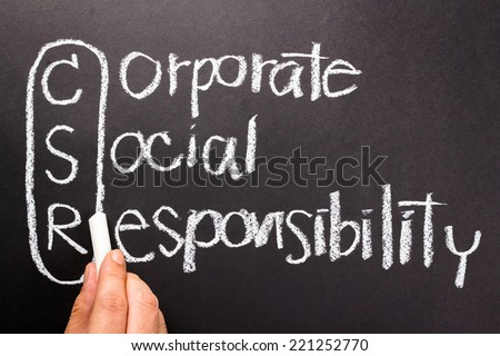 Corporate social responsibility (CSR) handwriting with chalk