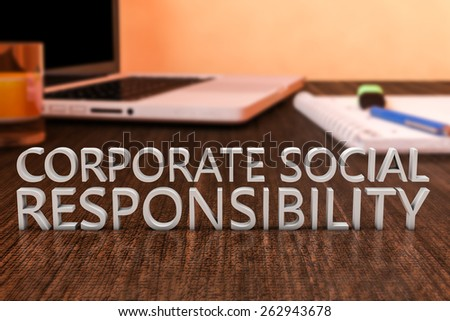 Corporate Social Responsibility - letters on wooden desk with laptop computer and a notebook. 3d render illustration. - stock photo