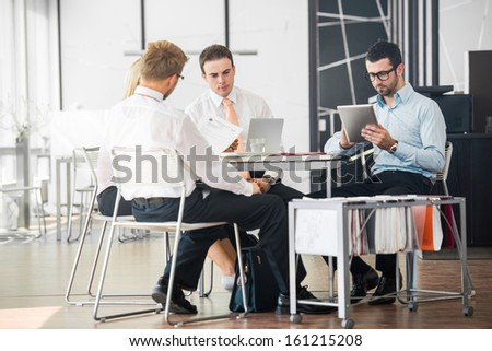 Corporate team working on a meeting in office - stock photo