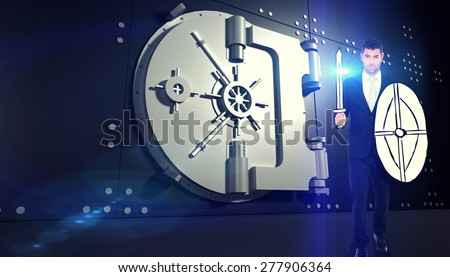 Corporate warrior against digitally generated locked safe - stock photo