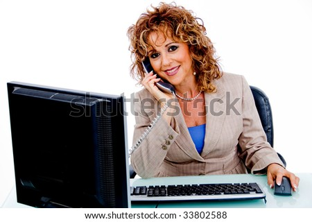 Corporate woman attending call - stock photo