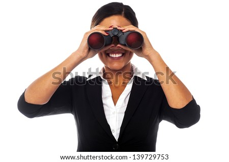 Corporate woman looking at you through binoculars