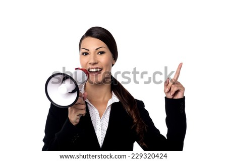 Corporate woman speaking over a megaphone  - stock photo
