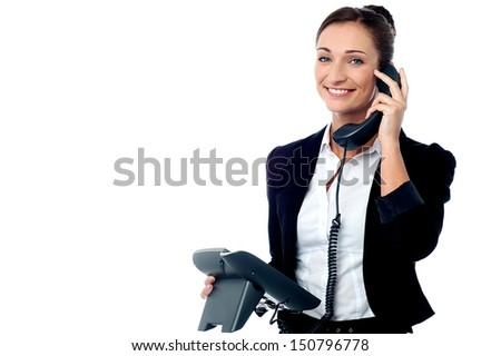 Corporate woman speaking to client over the phone - stock photo