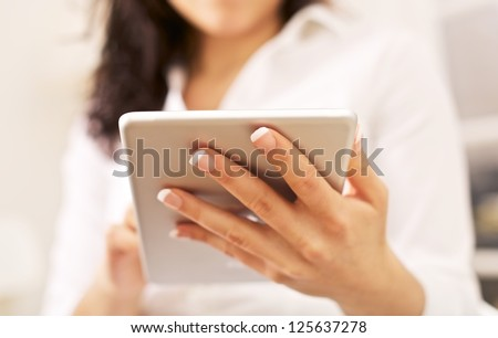 Corporate woman with portable tablet pc on her hand
