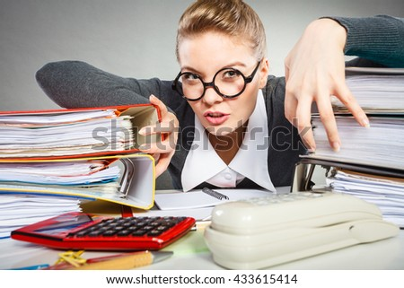 Corporation administration bureau clerk assistant concept. Scary office lady in her kingdom. Obsessed workaholic secretary at desk. - stock photo
