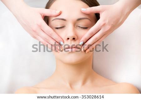 corrective facial massage - stock photo