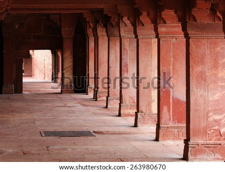 Corridor at Jama Masjid Mosque in Fatehpur Sikri, ancient city founded by Mughal emperor Akbar, one of the best preserved collections of Indian Mughal architecture  in Agra, Uttar Pradesh, India - stock photo