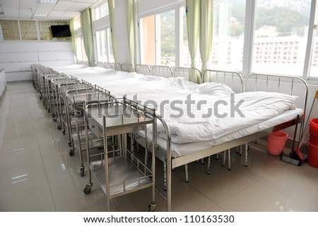 corridor in hospital with beds - stock photo