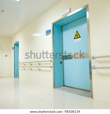 corridor in hospital with doors. - stock photo