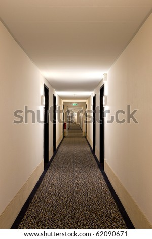 corridor in hotel with rooms entrances from both sides - stock photo