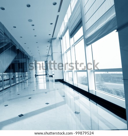 corridor in office building with big windows passing daylight - stock photo