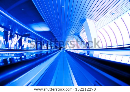 corridor interior of a business center with moving walkways in covered bridge Moscow City - stock photo