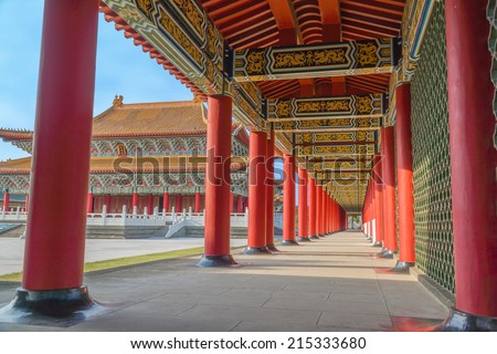 Corridor of A Confucius Temple and The Main Building of The Temple, Under Blue Sky. A  Stereo Type of Traditional Chinese Palace Architecture. The Temple is a Tourist Site in  Kaohsiung, Taiwan. - stock photo