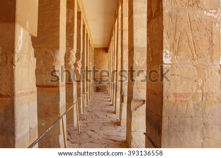 Corridor of columns in  the ancient temple of love of Hatshepsut near Luxor in Egypt in a rocky gorge near the valley of the kings. - stock photo