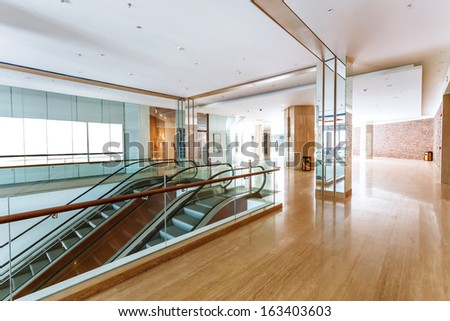 corridor of hotel with escalator