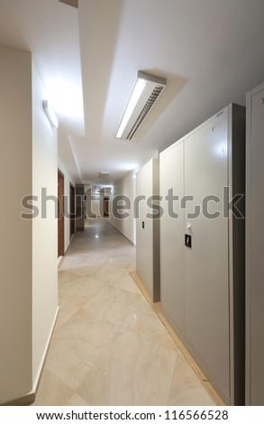Corridor with door and lamps - stock photo