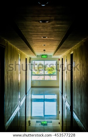 Corridor with light at window, Thailand.