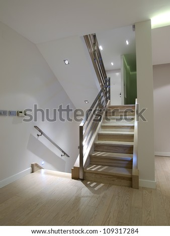 Corridor with stairs in modern apartment