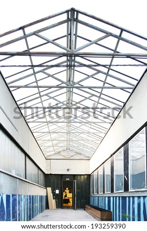 corridor with steel roof structure covered with glass