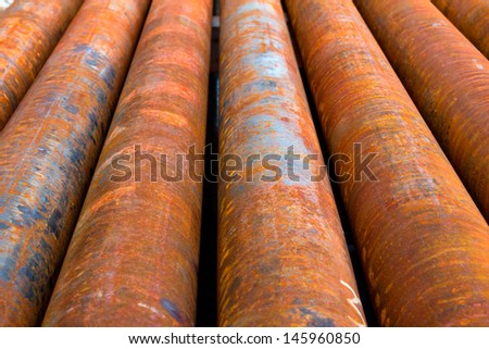 Corroded casing pipes situated near an oil well - stock photo