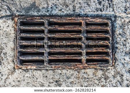 Corroded Rusty Storm Drain in concrete pierce in the sea - stock photo