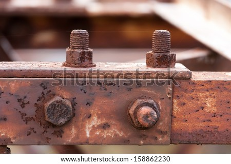 Corrosive rusted bolt with nut. - stock photo