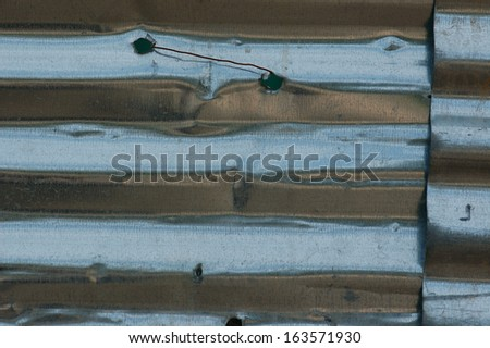 Corrugated aluminum construction fencing. Grungy metal background. - stock photo