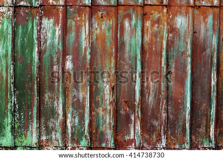 Corrugated Brown Green Rusty Colored Metal Cracked Paint Grunge Texture - stock photo
