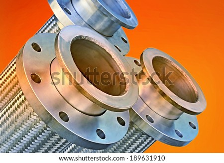 Corrugated flexible stainless steel metal hoses with flanges fittings. - stock photo