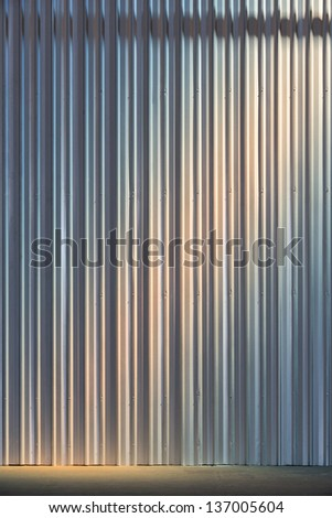 Corrugated metal sheet wall background texture inside of building - stock photo