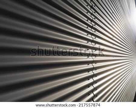 corrugated metal warehouse facade abstract - stock photo