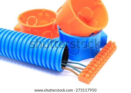 Corrugated plastic pipe, electrical cable with connection cube and electrical box, component for use in installations. Isolated on white background - stock photo