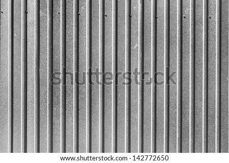 Corrugated zinc metal texture may be used as background - stock photo