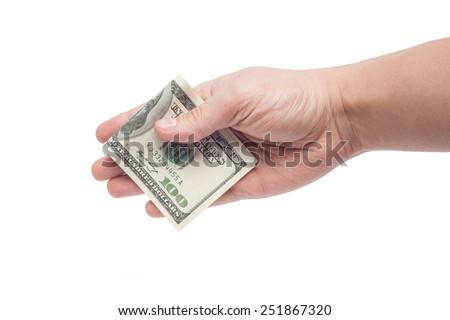 corruption concept: hand giving bribe 100 USD - stock photo