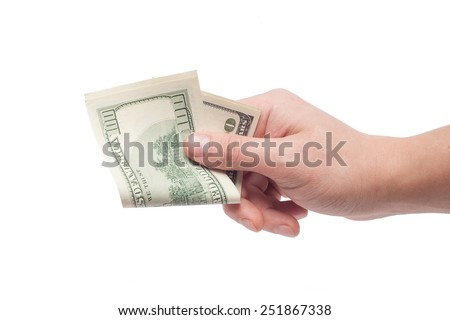 corruption concept: hand giving bribe 100 USD